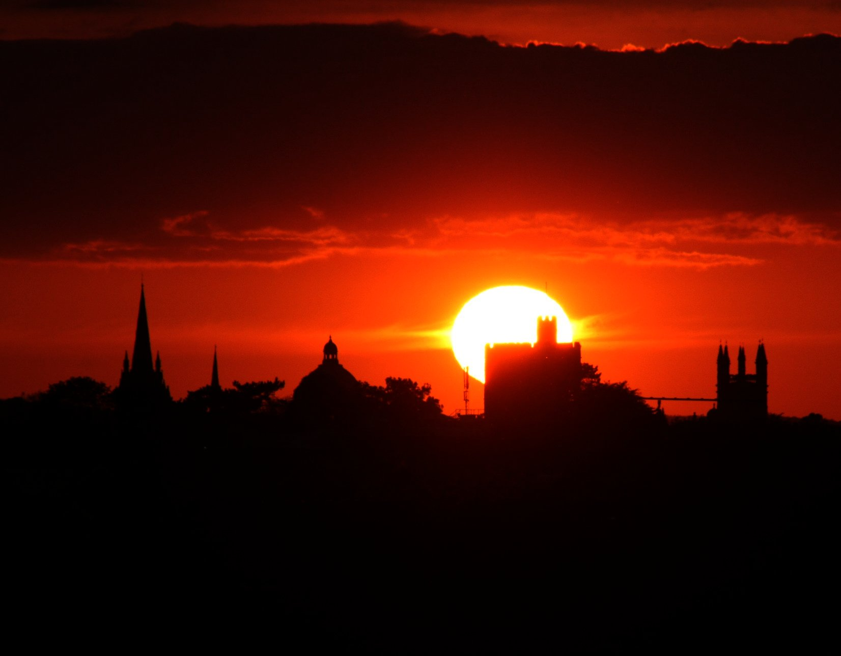 deep red sunset over Oxford skyline